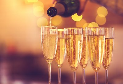 Champagne Poured into Glasses