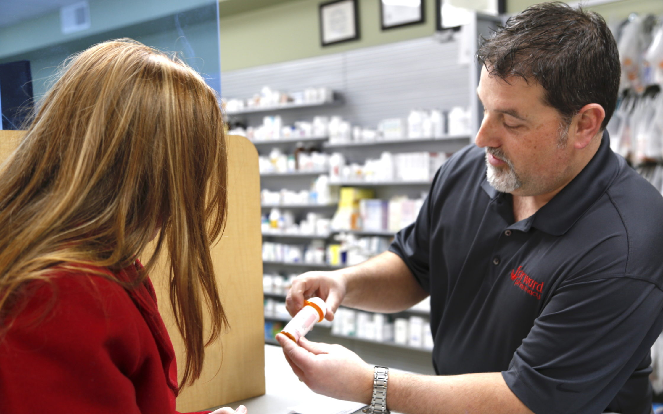 Matt Mabie, RPH helping a pharmacy patient