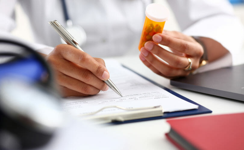 Pharmacist Looking at mediation