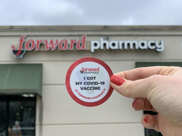 Vaccination sticker in front of Forward Pharmacy location