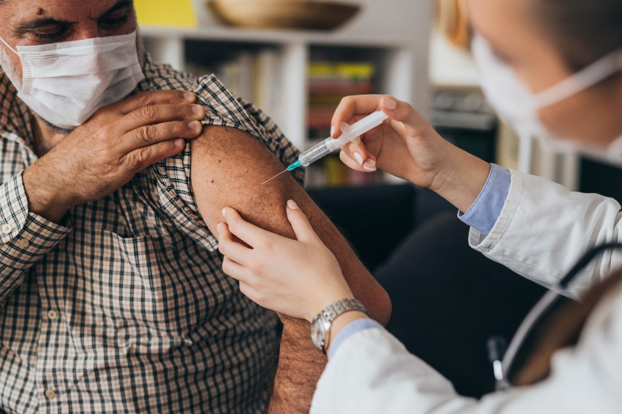 Person receiving vaccination