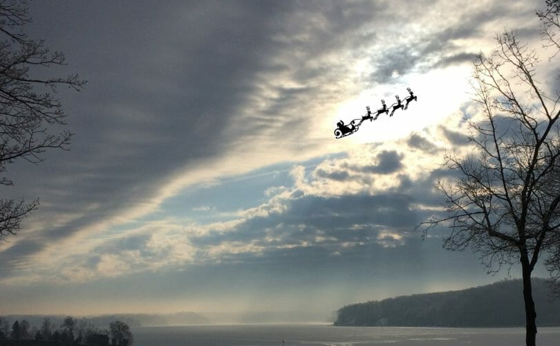 Santa flying in the sunlight