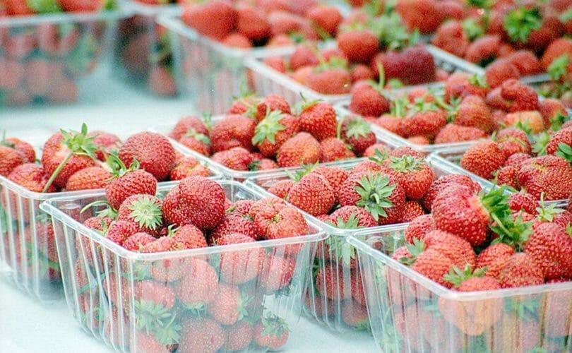 Bins of Strawberries On Table