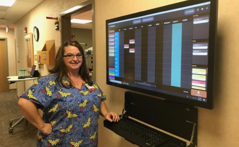 Darla Coullard, ophthalmic assistant, using the eSynchrony board.