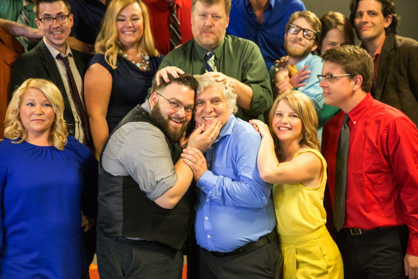 Improv Troupe Members Hugging