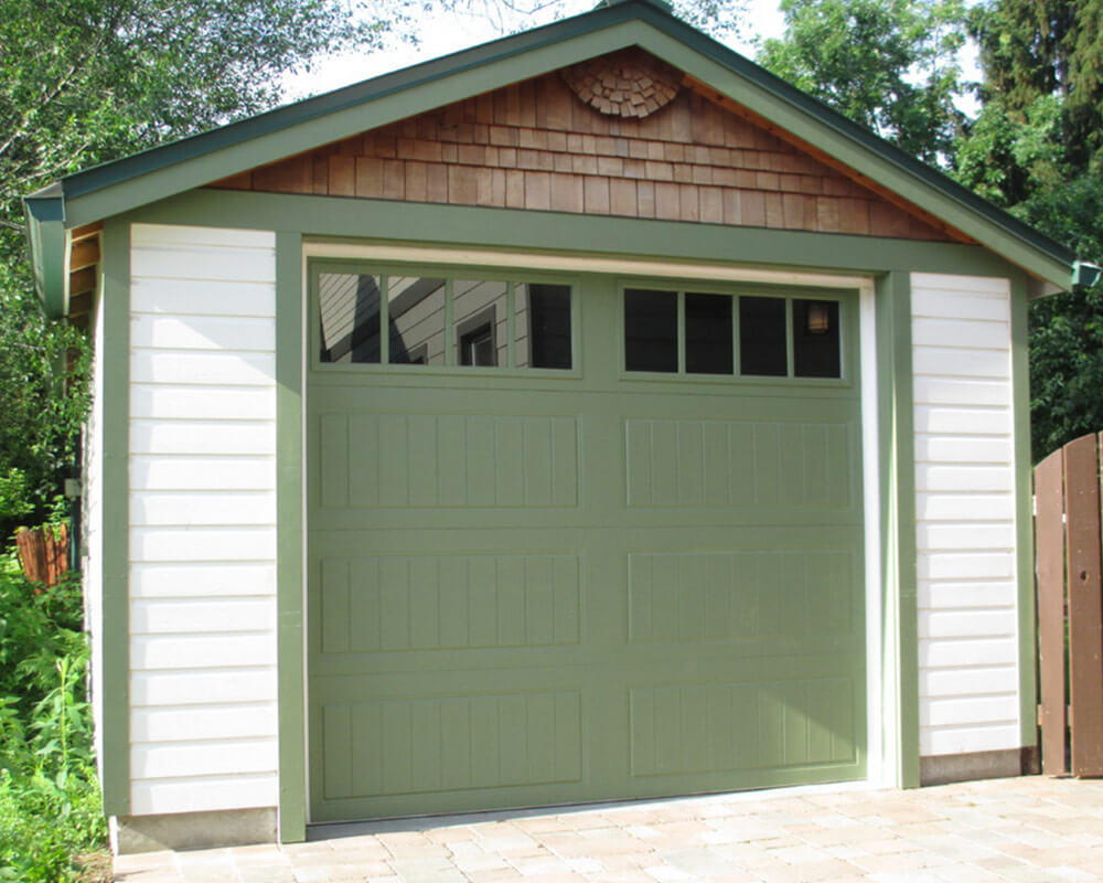 Exterior updates to siding, fascia, and door of garage on this residential addition project.