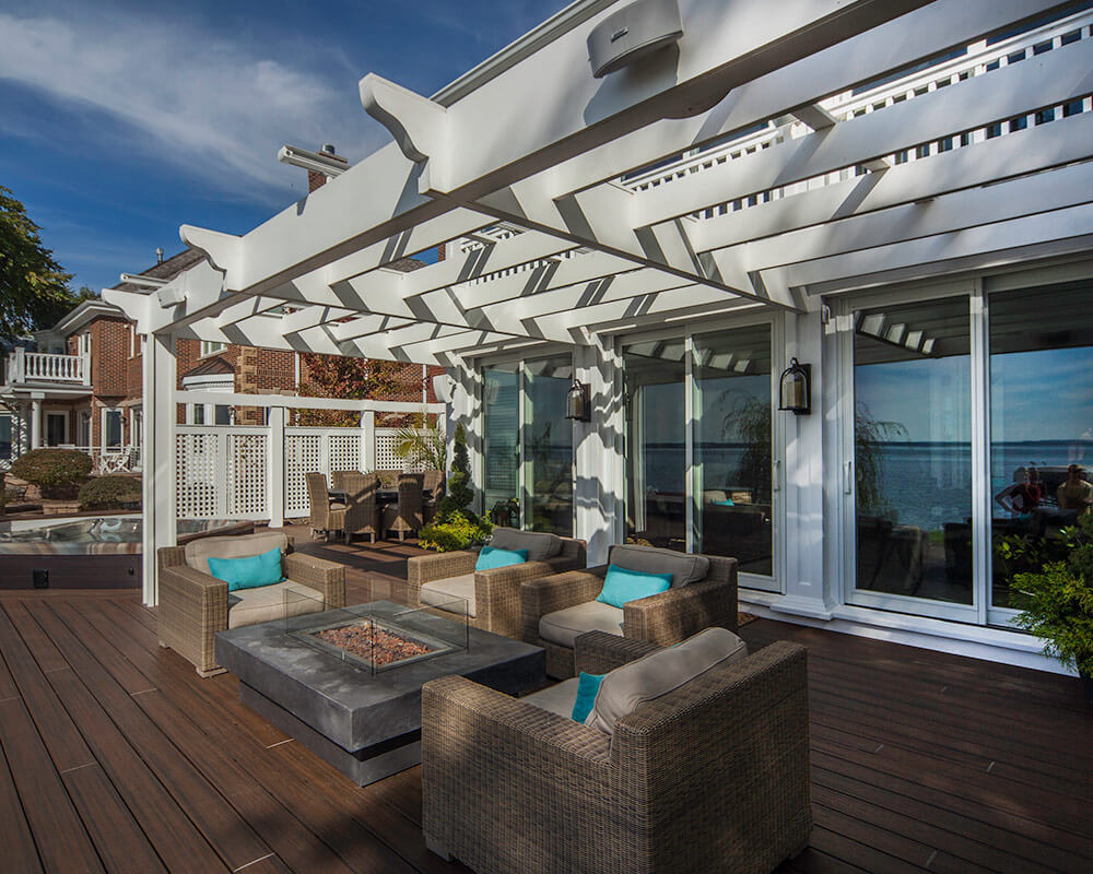 Custom designed exterior remodeling to match the style of the home and create an deck entertainment area that overlooks Lake Mendota, by TDS Custom Construction.