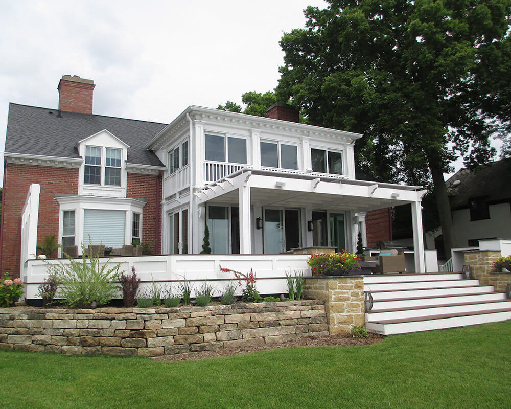 Custom designed exterior deck remodel to match the style of the home and create an entertainment area that overlooks Lake Mendota, by TDS Custom Construction.
