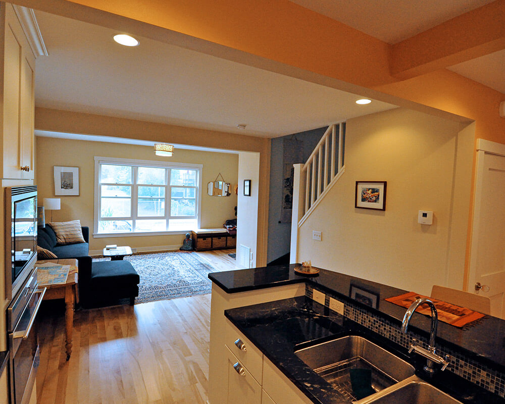 Interior remodel to a petite two-story house. Additional windows added to bring in natural light, and locally sourced products were used.