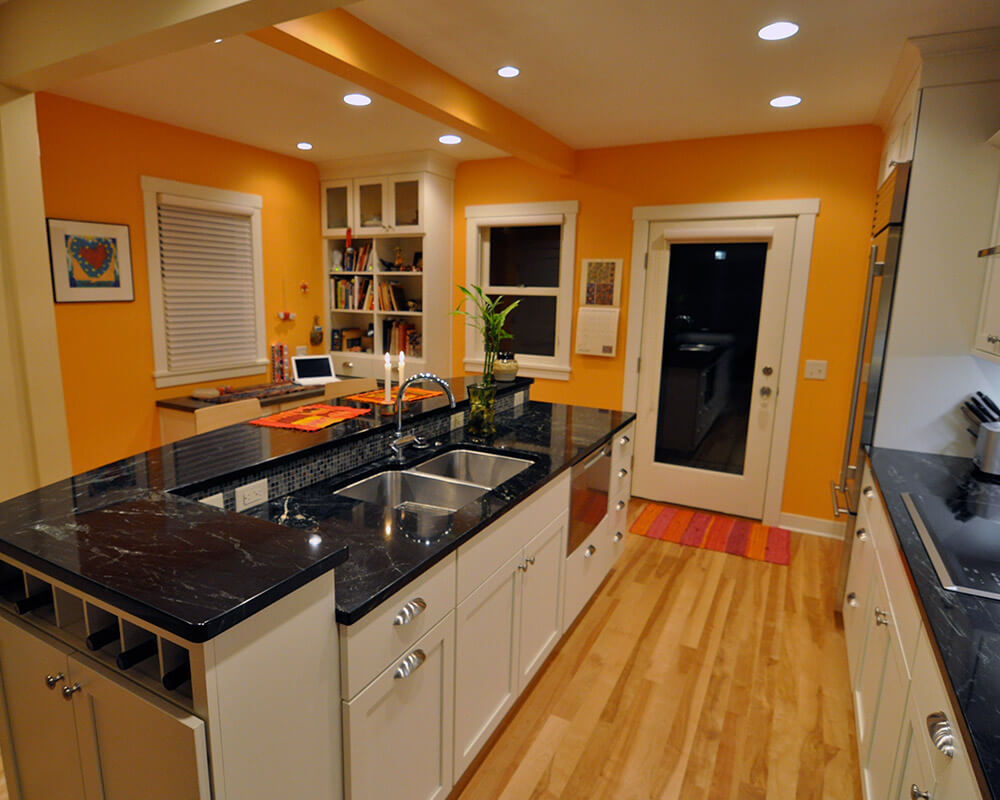 New kitchen remodel, opened up and with a center island, using sustainable, locally sourced products. By TDS Custom Construction.