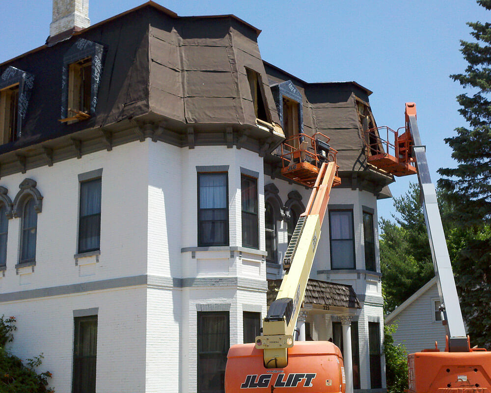 Process photograph of the historic preservation of a 1880's Second Empire Victorian home in Portage, WI.