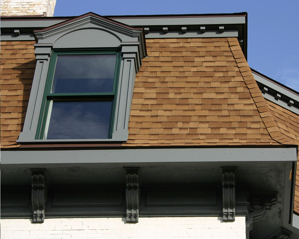 Historic preservation of this unique home included restoring the dormers and trim, by TDS Custom Construction.