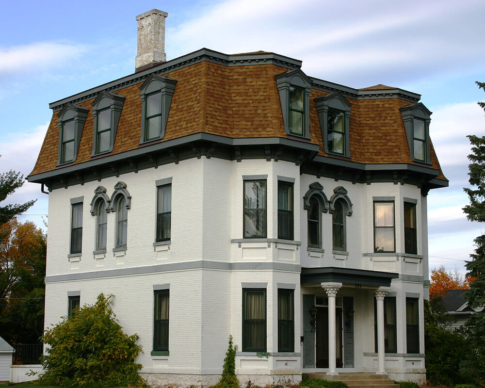 Unique historic preservation of a 1880's Second Empire Victorian home in Portage, WI by TDS Custom Construction.