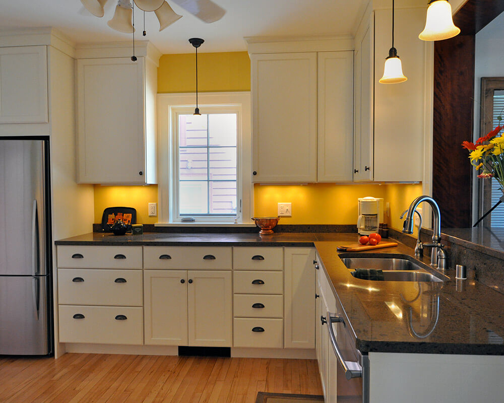 Updated kitchen remodel with Woodharbor custom cabinets and soapstone countertops in Madison, WI.