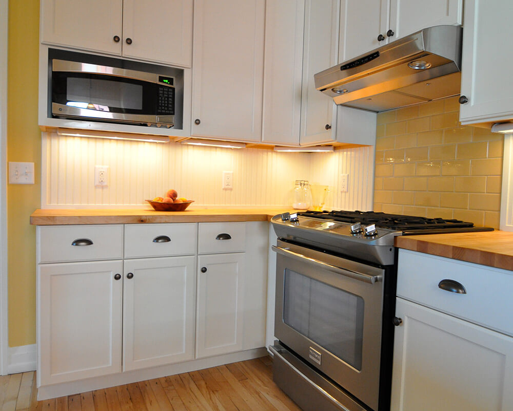 Custom design/build kitchen remodel for a more efficient kitchen with plenty of storage, multiple work zones, and butcher block countertops by TDS Custom Construction.