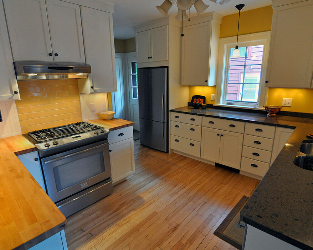 Updated kitchen remodel with custom cabinets and soapstone and butcher block countertops in Madison, WI.