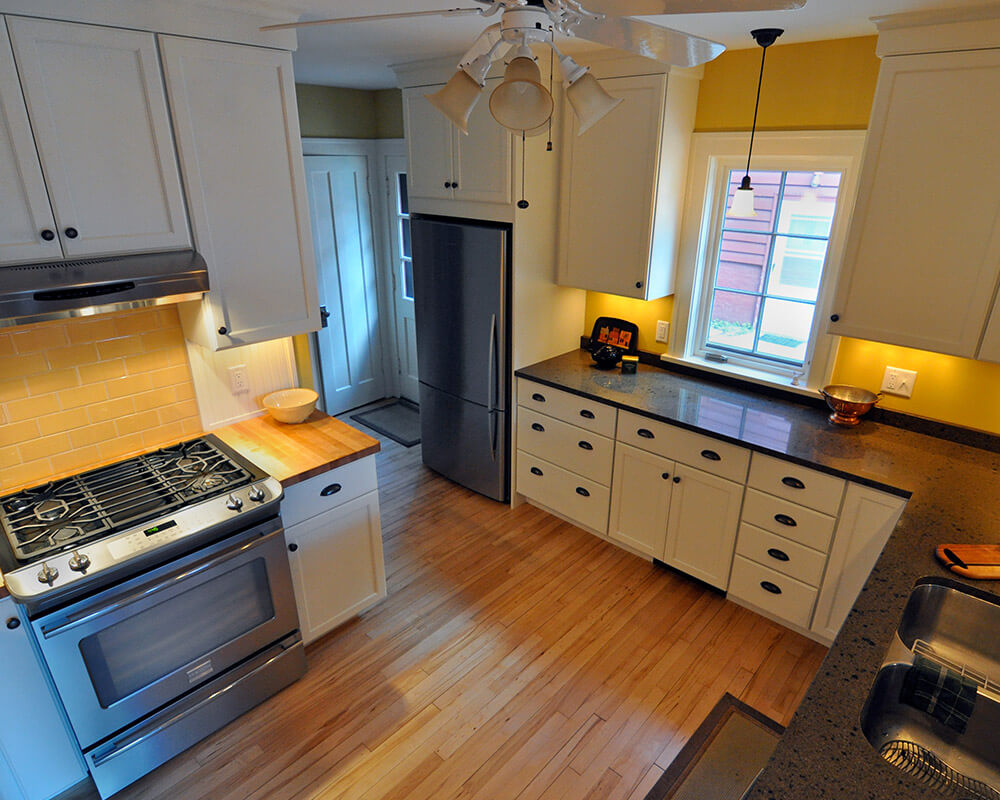 Kitchen remodel for a more efficient kitchen with plenty of storage, multiple work zones, and Woodharbor custom cabinets in Madison, WI.