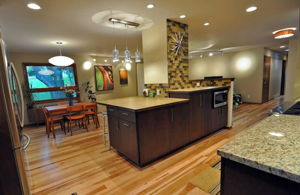 TDS Custom Construction provided an energy efficient, green and sustainable design and interior renovation. Opened up kitchen, dining and living rooms to the front entry.