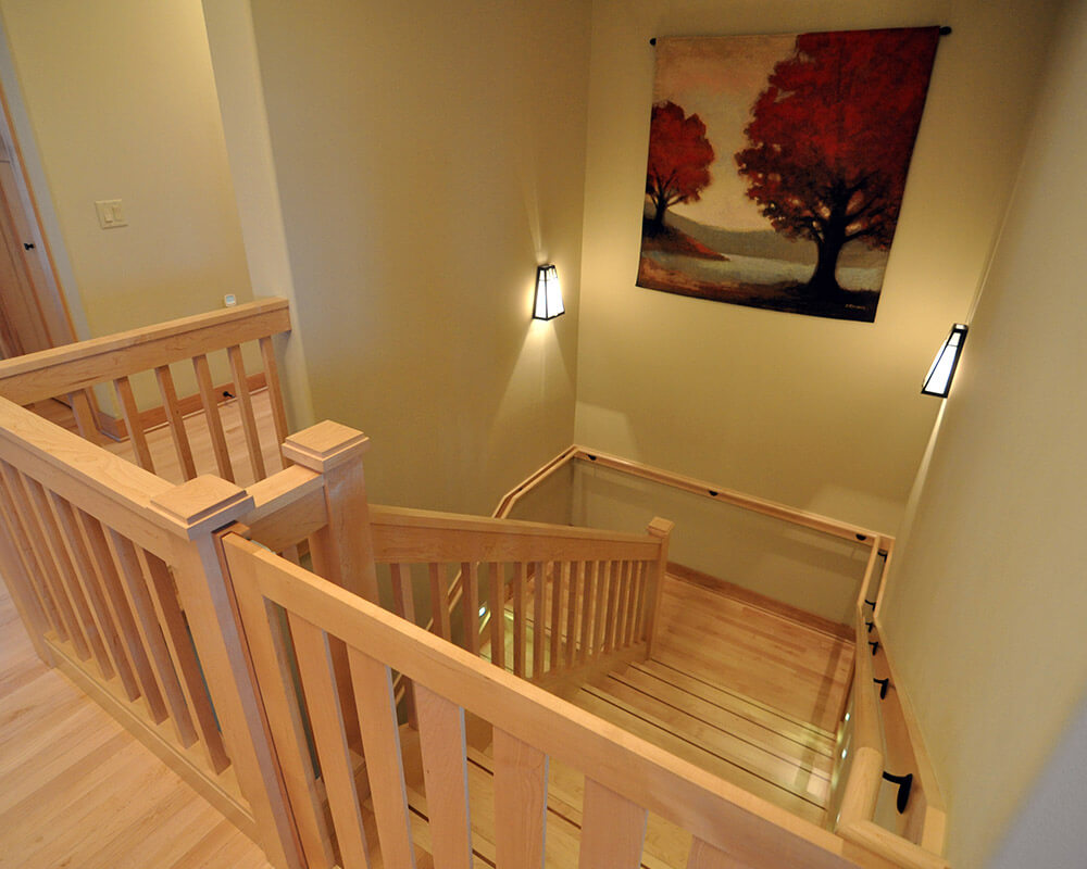 Stairway in this new home designed for aging in place in Oregon, WI.