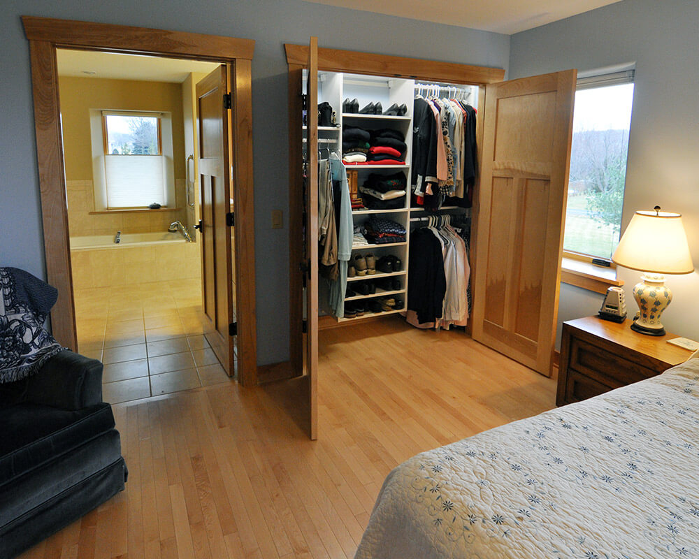 Bathroom and closet of primary suite in this new home designed for aging in place in Oregon, WI.
