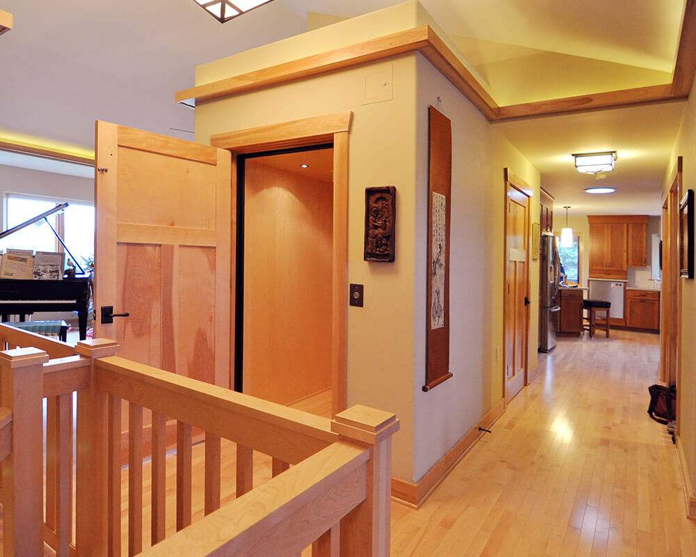 Wide hallways and a residential elevator in this new home designed for aging in place.