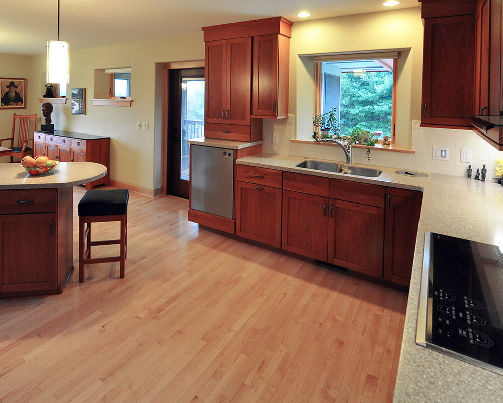 Cherry kitchen cabinets designed for aging in place in this custom design/build high performance new home by TDS Custom Construction.