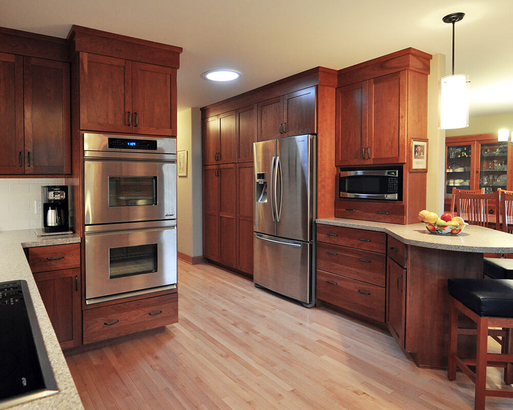 Custom design/build kitchen with Universal Design principles in place in this cherry kitchen remodel by TDS Custom Construction.