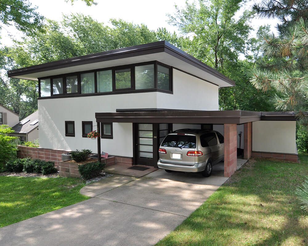 Exterior remodeling and home addition included stucco work, brick work, painting, new windows, and a new rubber roof by TDS Custom Construction.