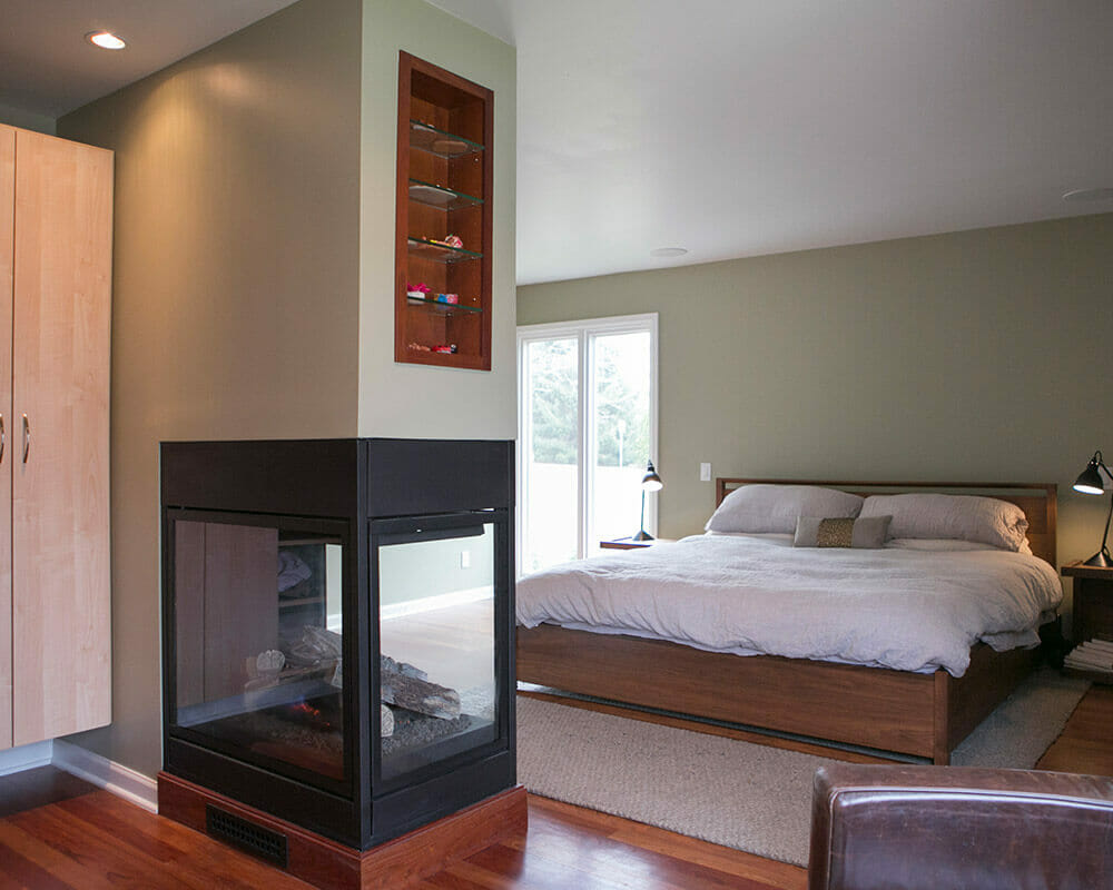 Primary suite with custom bathroom remodel, 3 sided fireplace, and walk-in primary closet by TDS Custom Construction.