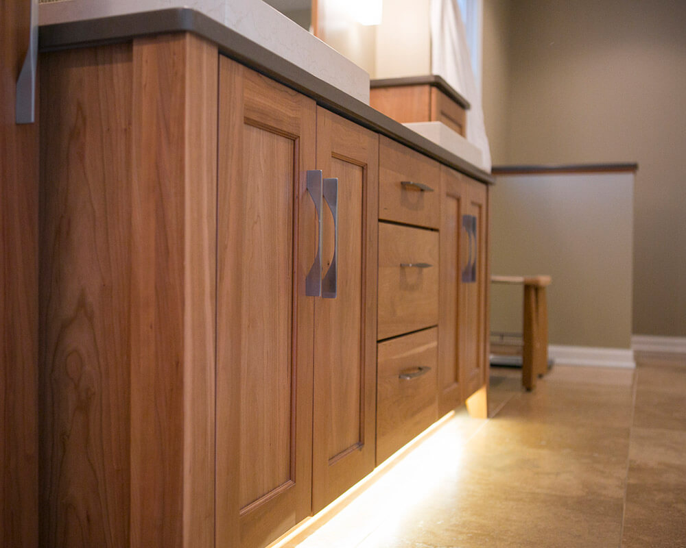 Custom bathroom remodel using Woodharbor custom cherry cabinetry and quartz countertops in Madison, Wisconsin by TDS Custom Construction.