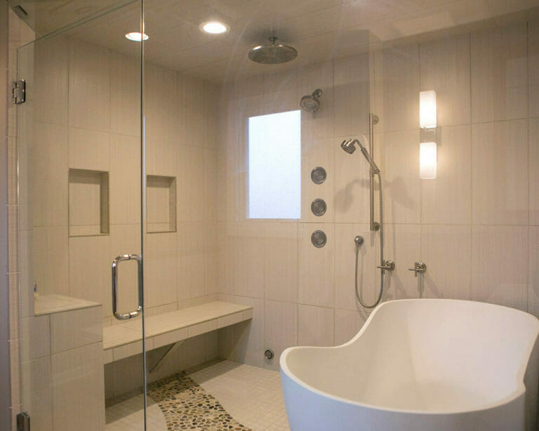 Custom bathroom remodel using locally sourced river rocks, custom tile, Kohler fixtures, and steam shower in Madison, Wisconsin by TDS Custom Construction.