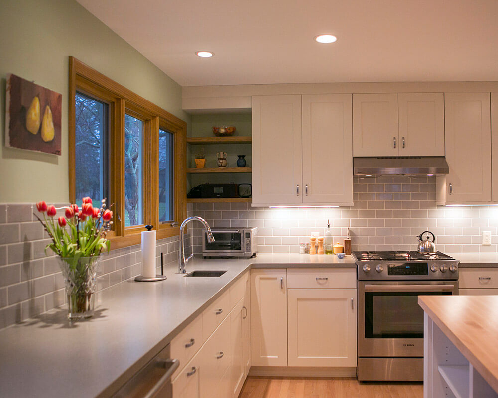 Midcentury modern inspired kitchen remodel with contemporary finishes by TDS Custom Construction.