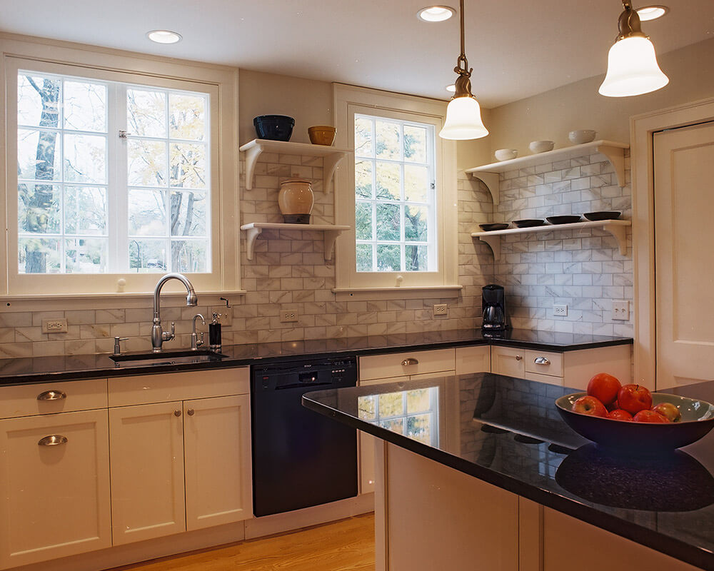 Clean and traditional kitchen remodel with custom cabinetry by TDS Custom Construction.