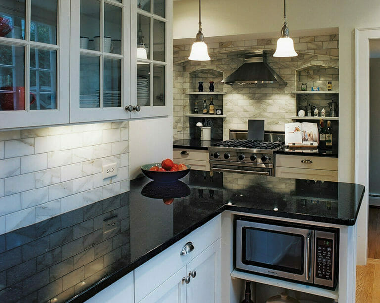 Traditional kitchen remodel with white custom cabinetry and granite countertops in Madison, Wisconsin.
