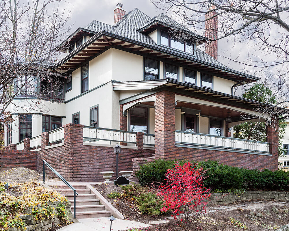 Exterior historical preservation and remodeling such as painting, tuck-pointing, and roofing to maintain this historic Madison, WI home.