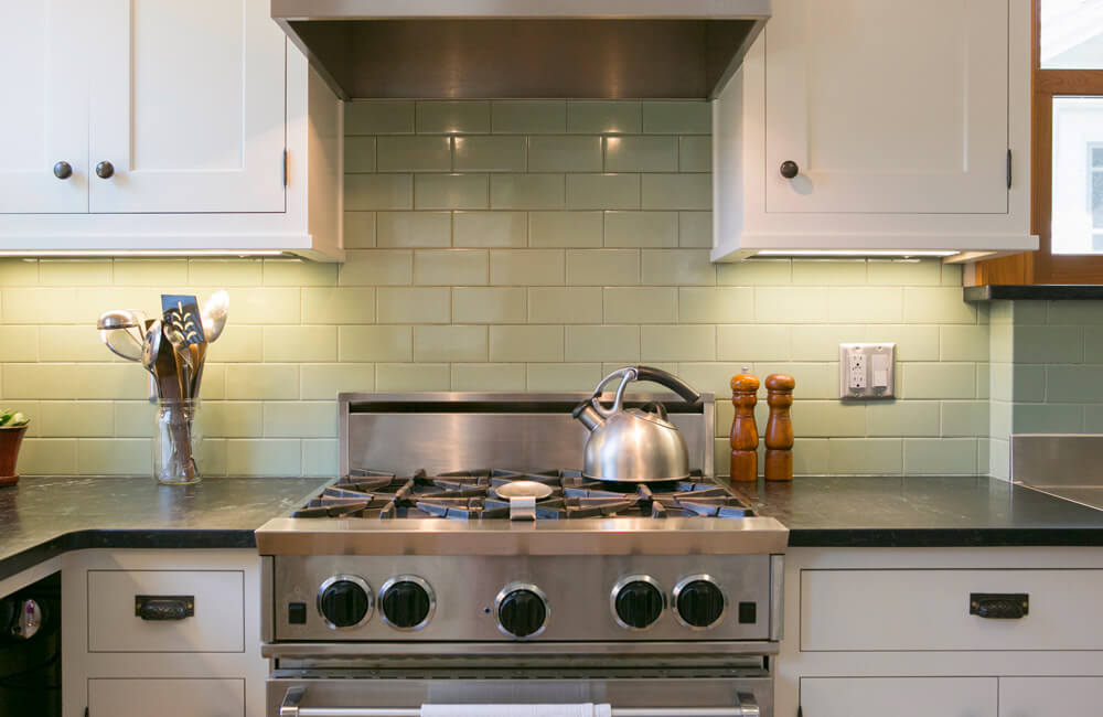 Simple and classic kitchen remodel that added much-needed space for multiple cooks in the kitchen in Madison, WI