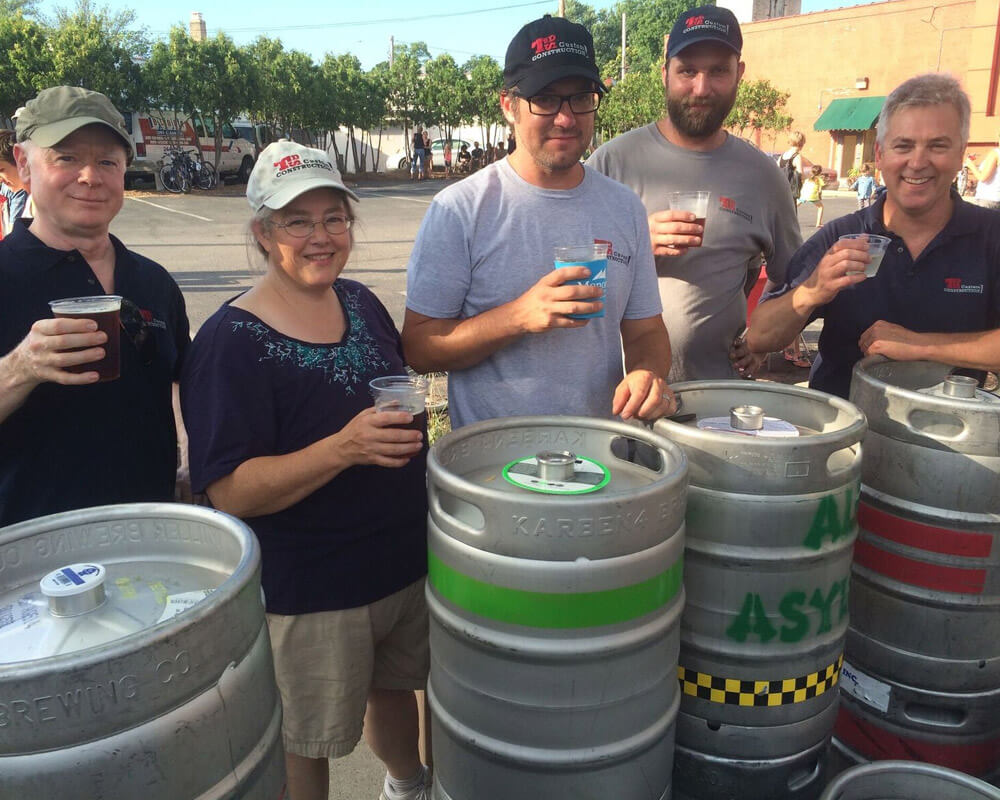 TDS Employees serve beer at the Atwood Fest in Madison, WI.
