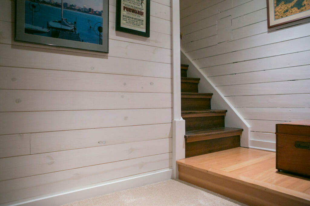 Newly remodeled stairs to basement in Madison, WI, by TDS Custom Construction.