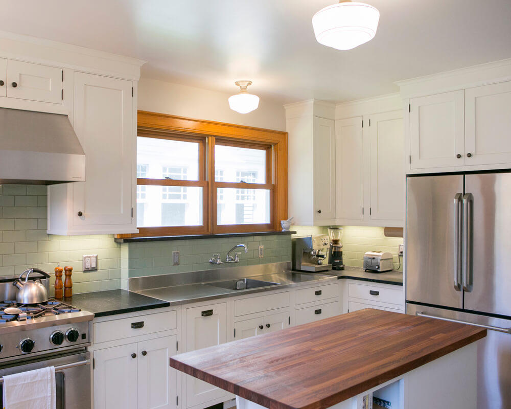 Kitchen remodel with custom Woodharbor inset cabinets, granite and Lyptus countertops by TDS Custom Construction in Madison, WI