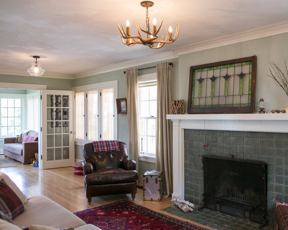 Living room view of the historic preservation of a Madison, Wisconsin 1920's Lake Mendota home. Original fireplace.