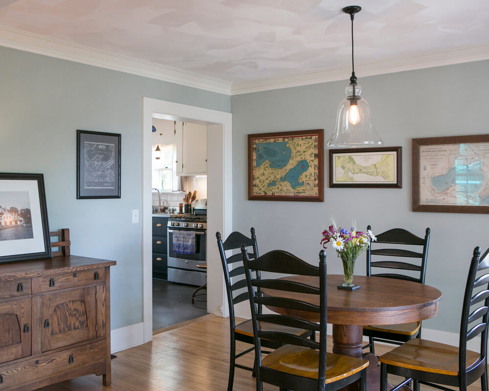 Dining room and kitchen view of a Madison, Wisconsin historic preservation remodel by TDS Custom Construction.
