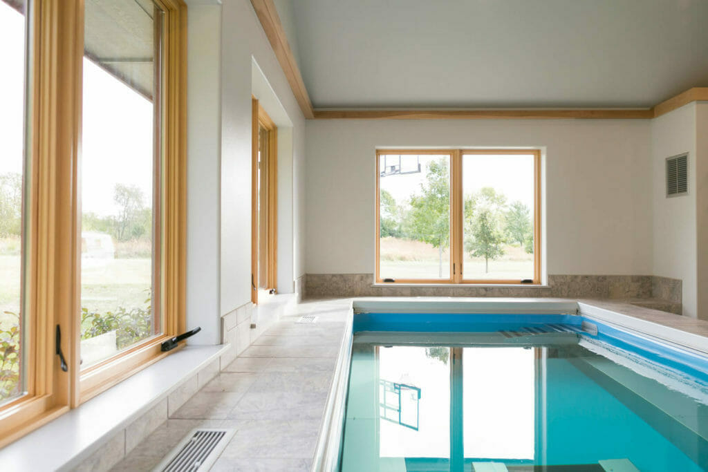 Endless Pool® addition with underwater treadmill in this new home designed for aging in place in Oregon, WI.