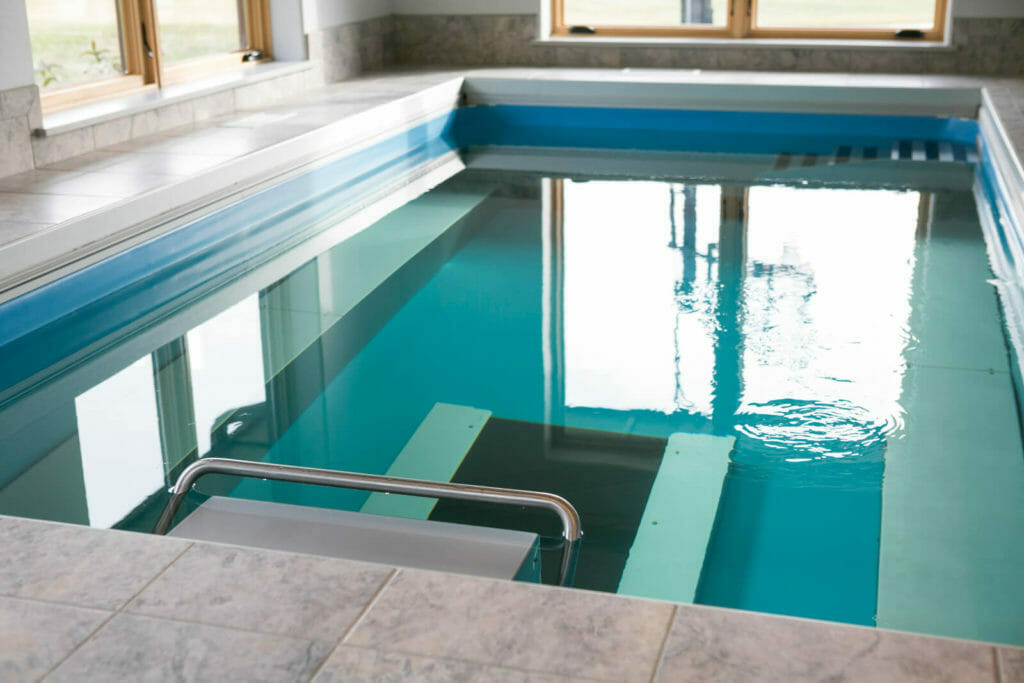 A heated resistance pool and underwater treadmill addition for this universally designed high performance home.