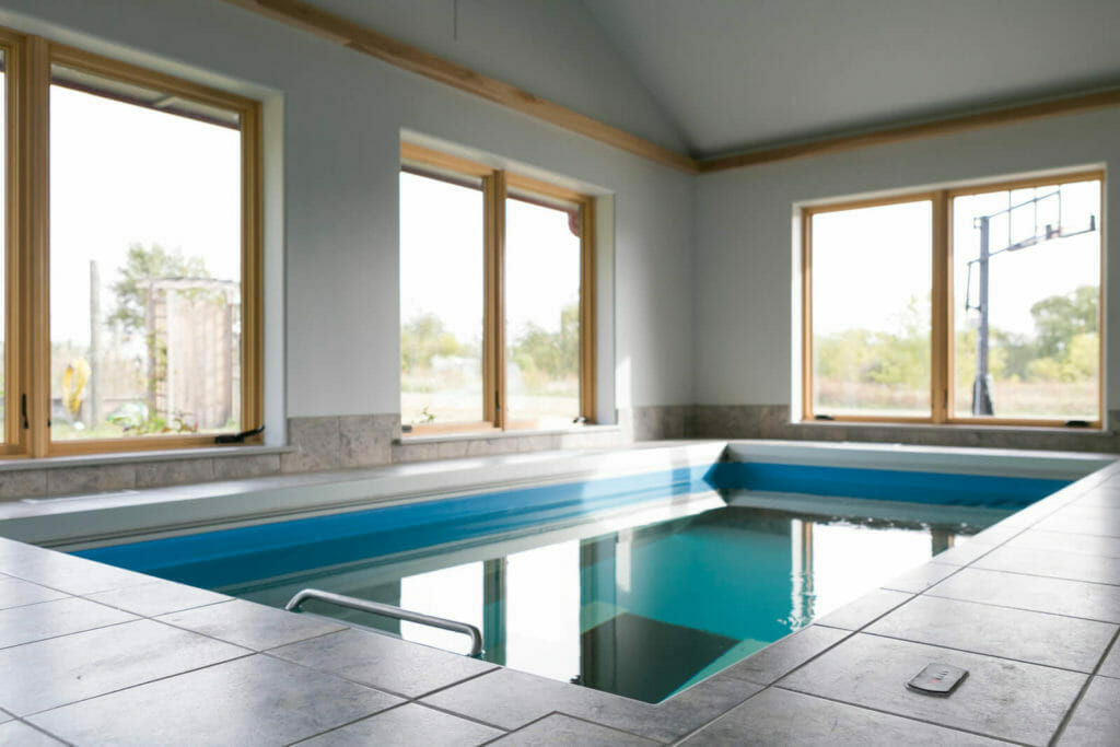 Pool addition with underwater treadmill in this new home designed for aging in place in Oregon, WI.