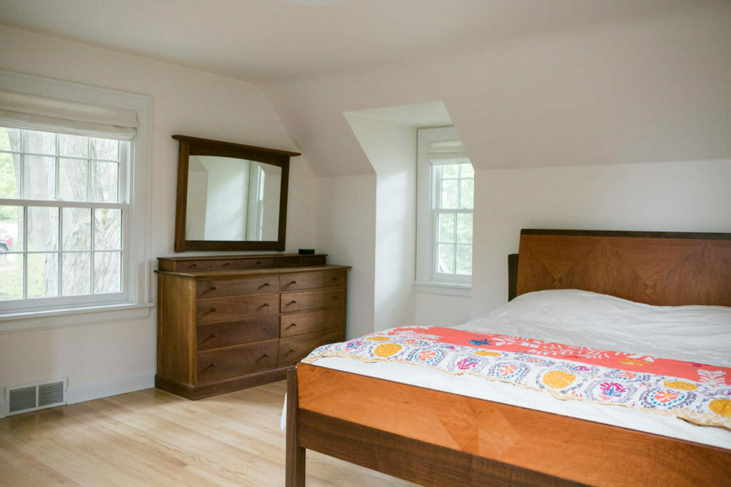 The primary bedroom in this Maple Bluff, WI whole home remodel was maximized with painted built-in cabinetry, skylights, and clean lines.