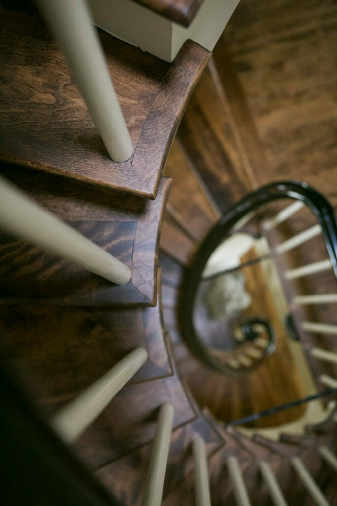 Refinished spiral staircase as part of the historic renovation of a 1922 Frank Riley Colonial Revival home in Madison, Wisconsin.