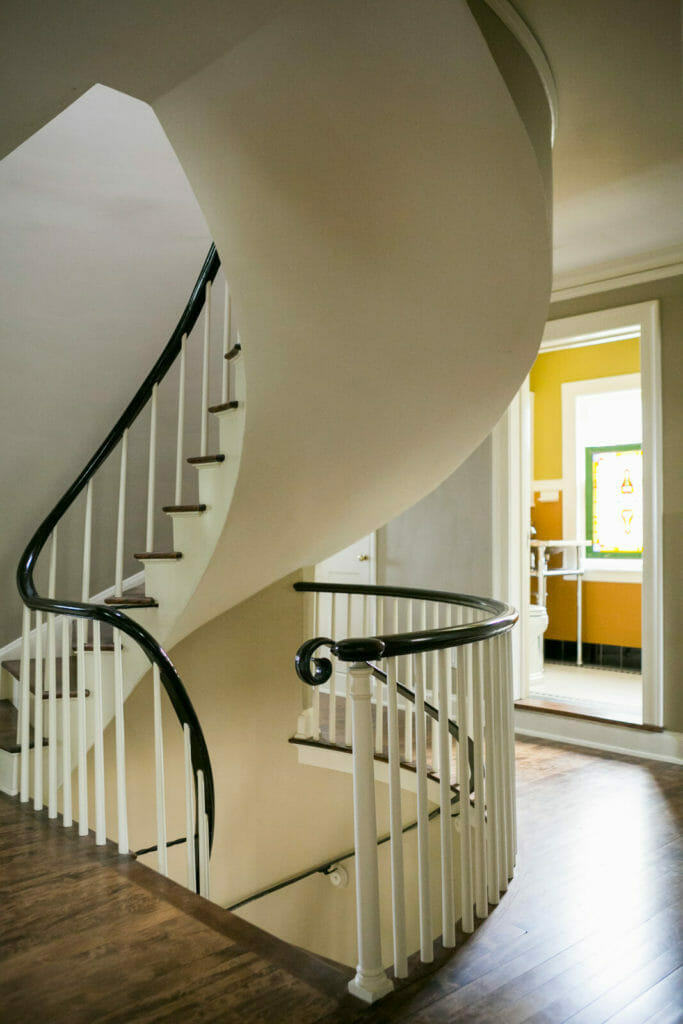 Refinished spiral staircase as part of the historic restoration of a 1922 Frank Riley Colonial Revival home in Madison, Wisconsin.