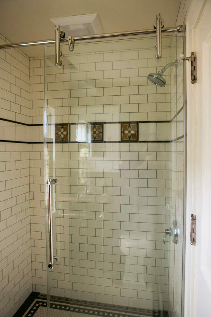 Updated bathroom with Motwai decorative shower tile in a historic restoration of a 1922 Frank Riley Colonial Revival home in Madison, Wisconsin.