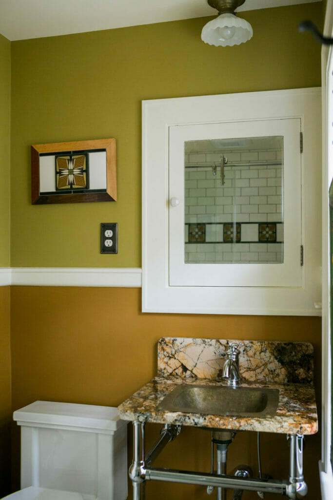 Updated bathroom with Motawi tile in a historic restoration of a 1922 Frank Riley Colonial Revival home in Madison, Wisconsin.