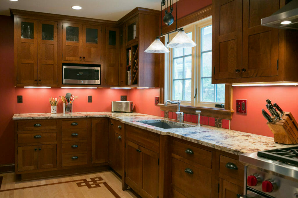 Granite countertops, cherry cabinets, and Brazilian cherry inlay and maple flooring in the kitchen of the historic restoration of a 1922 Frank Riley Colonial Revival home on the Isthmus in Madison, Wisconsin.